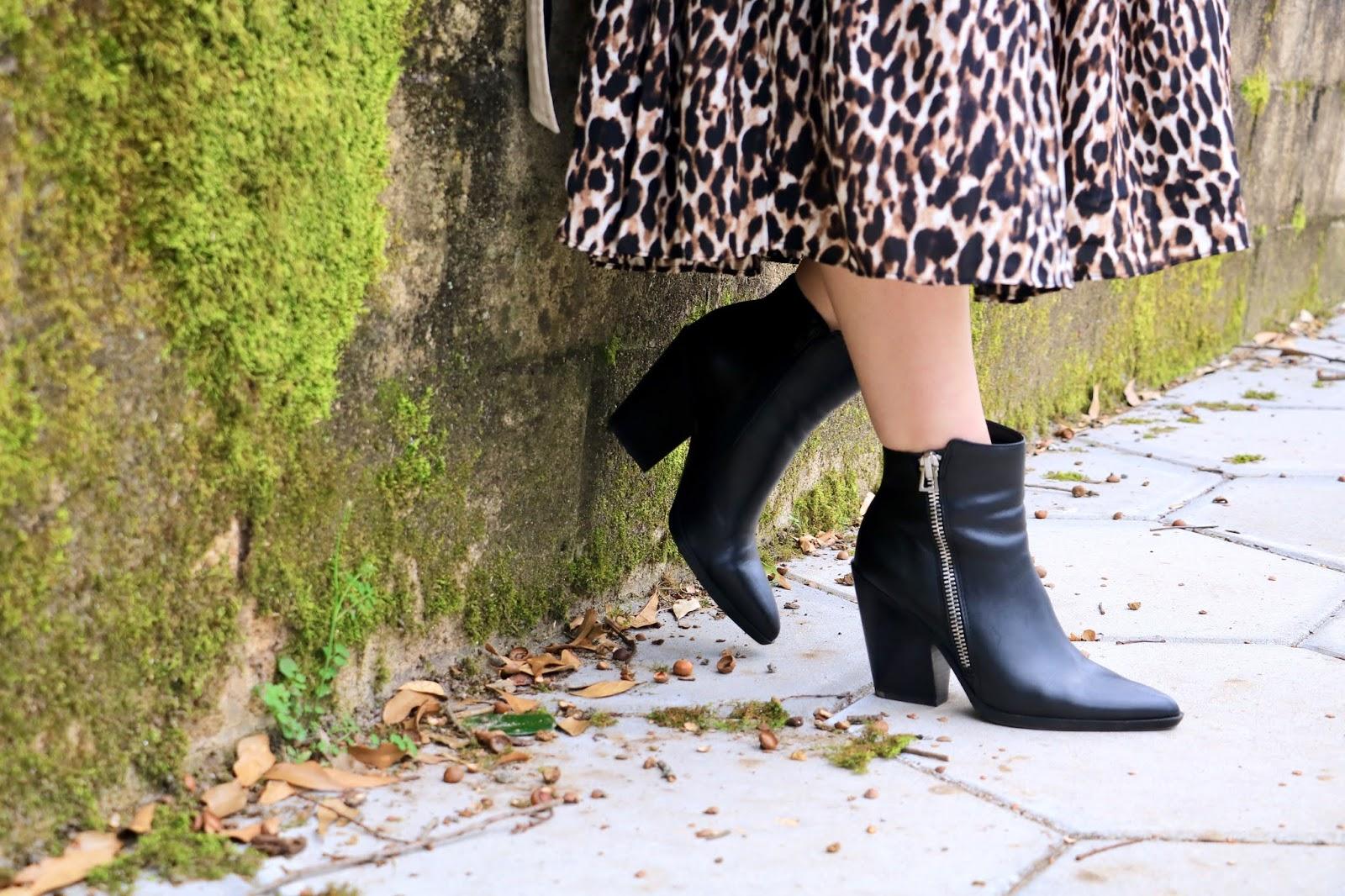 Nyc fashion blogger Kathleen Harper wearing Naturalizer black booties.