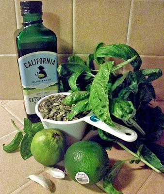 Olive oil, basil, limes, pumpkin seeds and garlic