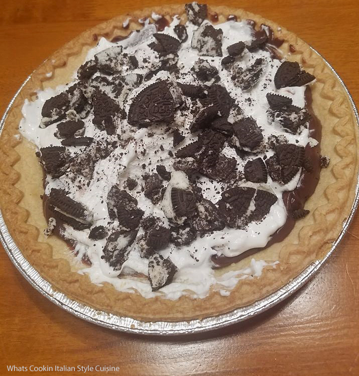 this is a classic chocolate cream pie decorated with oreos on top of the whipped cream