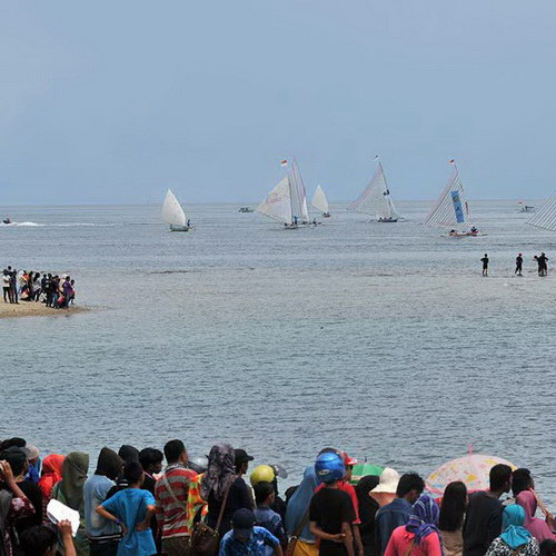 Tinuku Travel Pesona Tomini Bay Festival racing sailboat, underwater photography and culinary feast Lalampa in Central Sulawesi