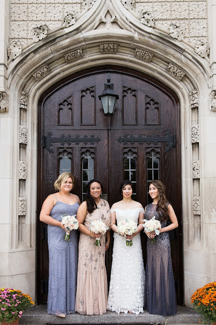 bridesmaids at Grosse Point Academy in front of doors