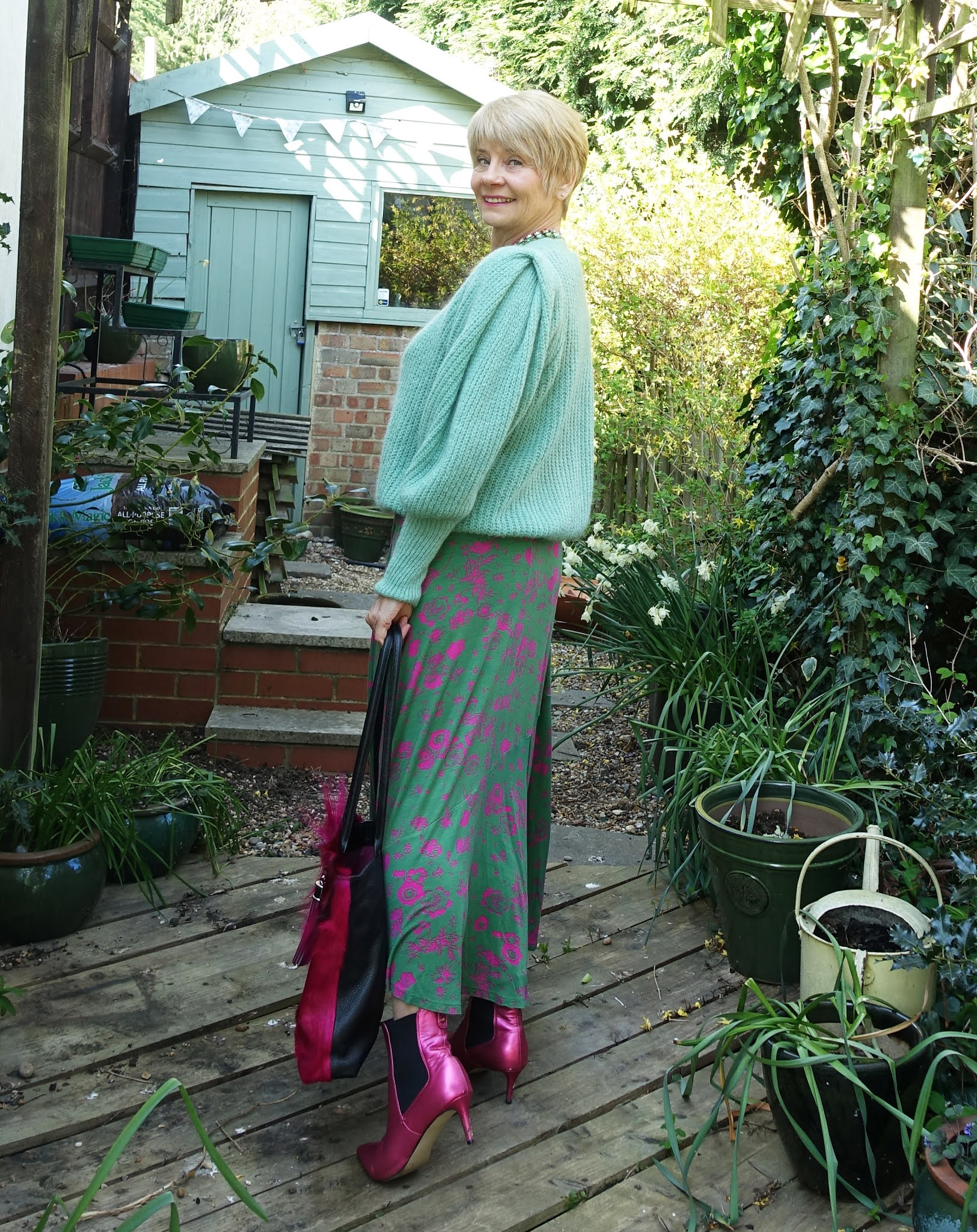 Summer dresses start to see the light of day in spring when worn with a light cardigan or sweater, as Gail Hanlon shows with her green mohair cardigan worn over a dress for the Style Not Age Challenge Spring Sweaters