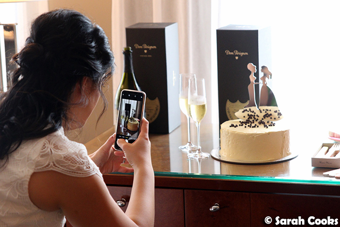 Bride instagramming wedding cake