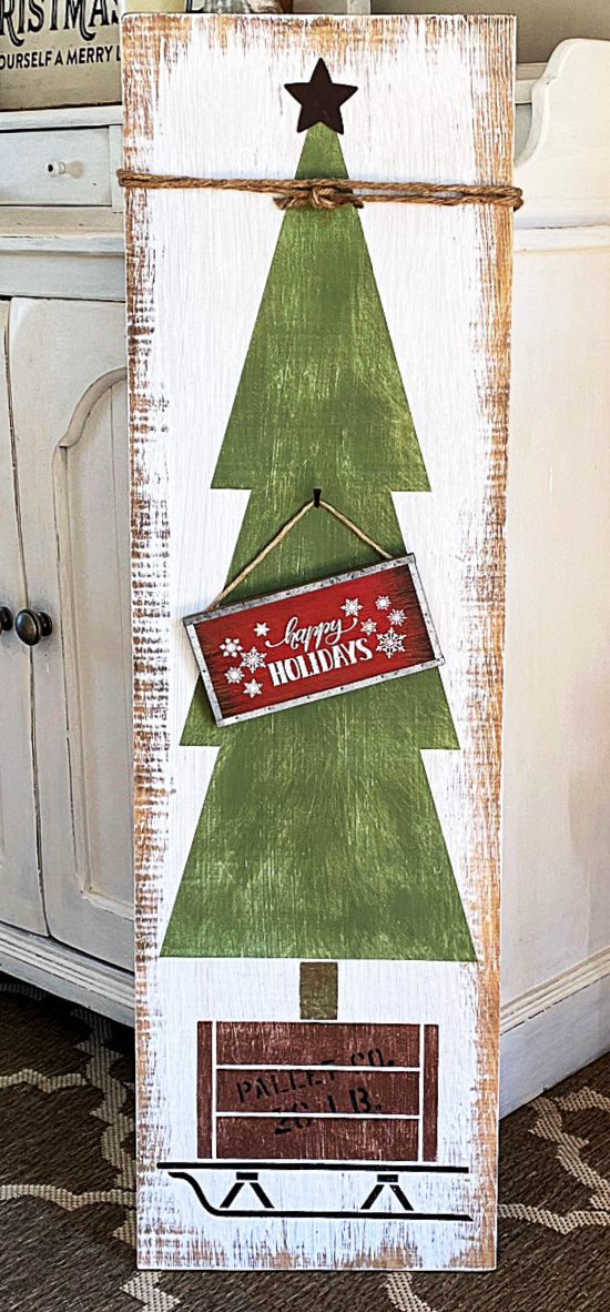 Christmas tree with a sign