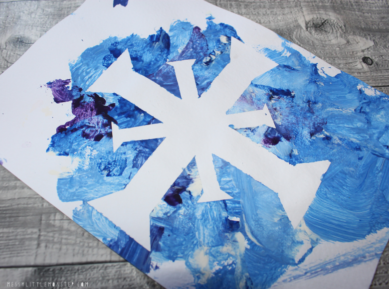 tape resist snowflake craft for toddlers and preschoolers