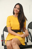 Actress Poojitha Stills in Yellow Short Dress at Darshakudu Movie Teaser Launch .COM 0213.JPG