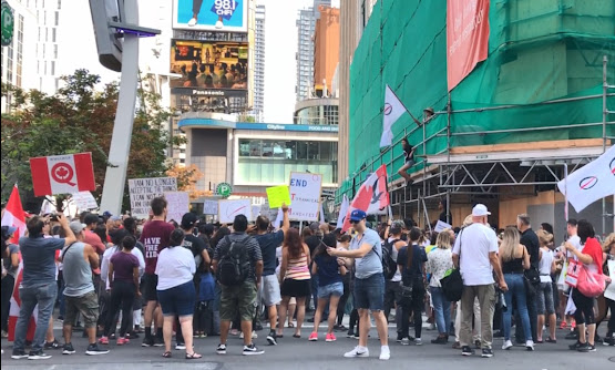 Toronto protest lockdown pandemic COVID-19 politics healthcare