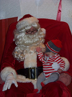 Tater Tot's picture with Santa on her first Christmas