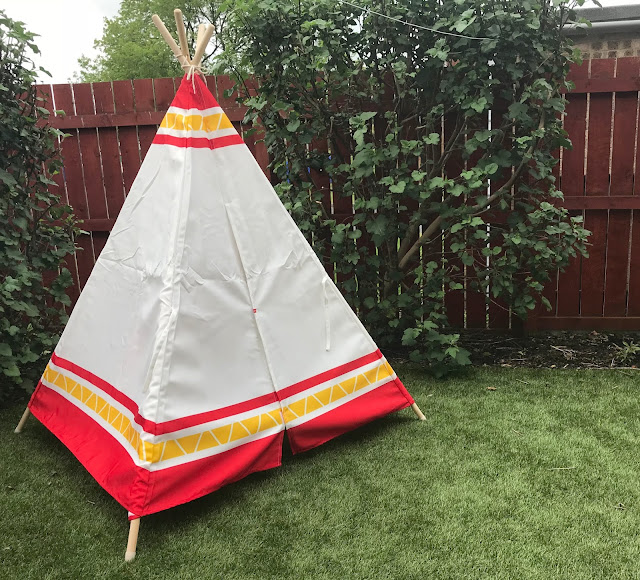 red white and yellow hape canvas child teepee in garden