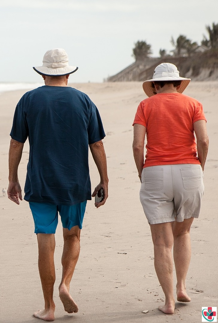 Senior couple walking in the beach