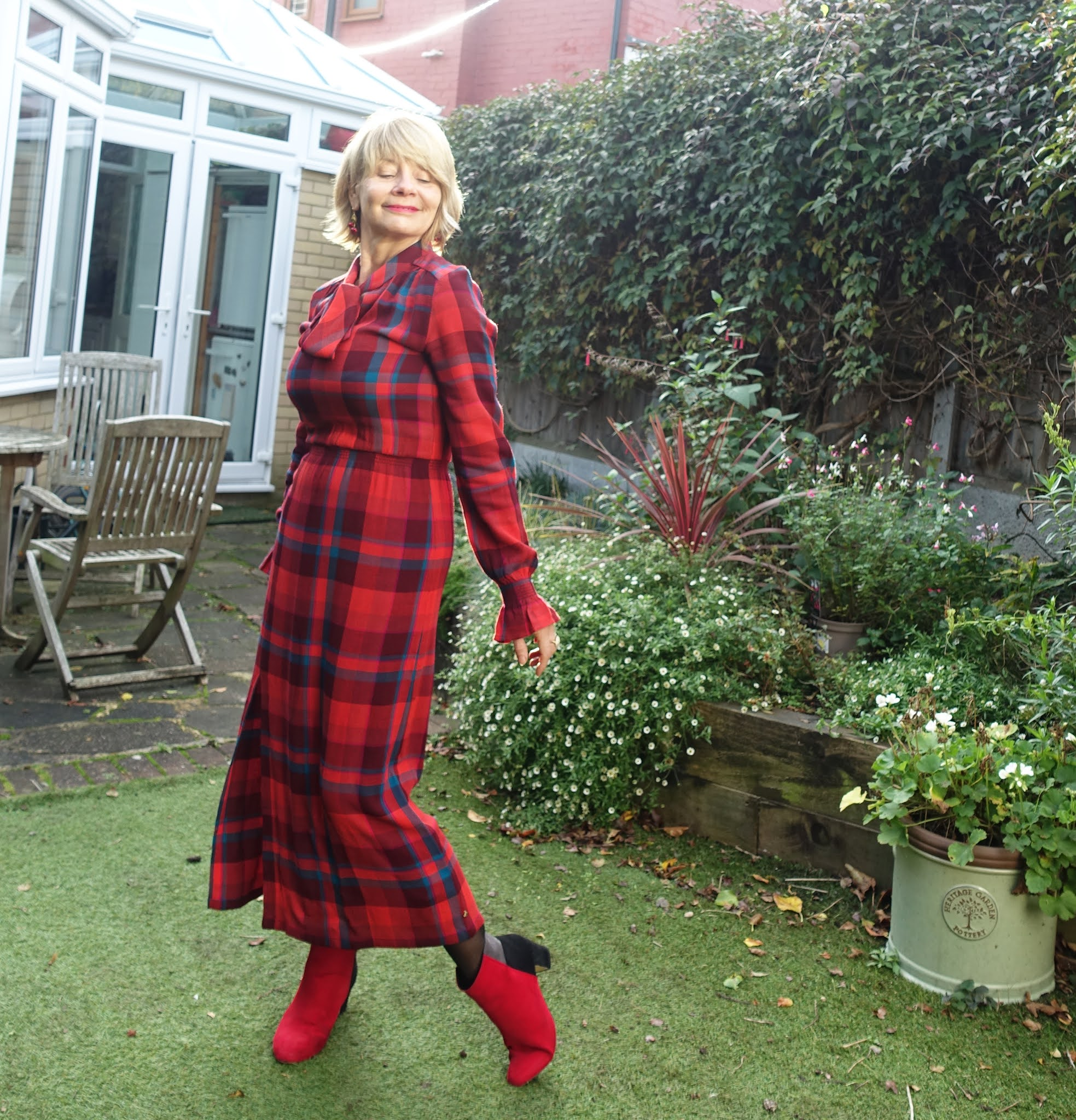 A red plaid dress with red and black boots worn by Is This Mutton style blogger Gail Hanlon