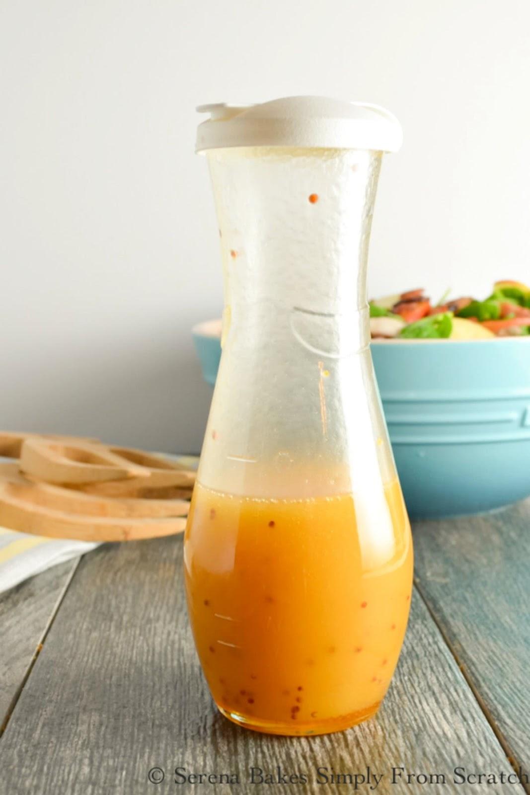 A shaker jar with Olive Oil, Apple Cider Vinegar, Mustard, Honey, and Salt for Honey Mustard Dressing.