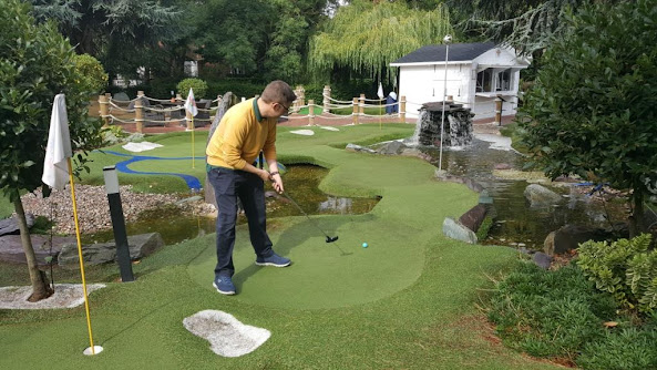 Richard Gottfried playing hole 3 of the Ryder Legends Mini Golf course at The Belfry