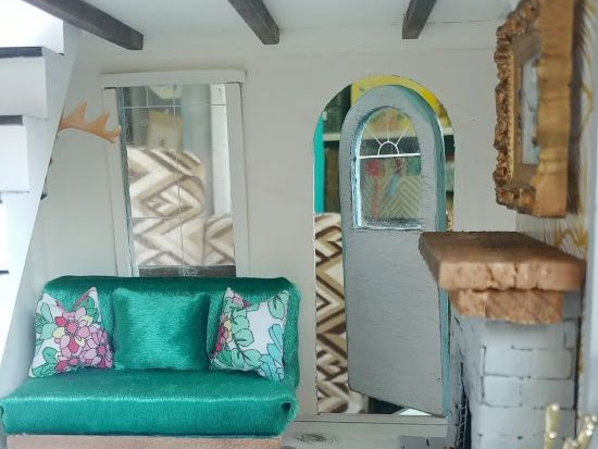 Dollhouse Couch, Taxidermy, and Wood Beams