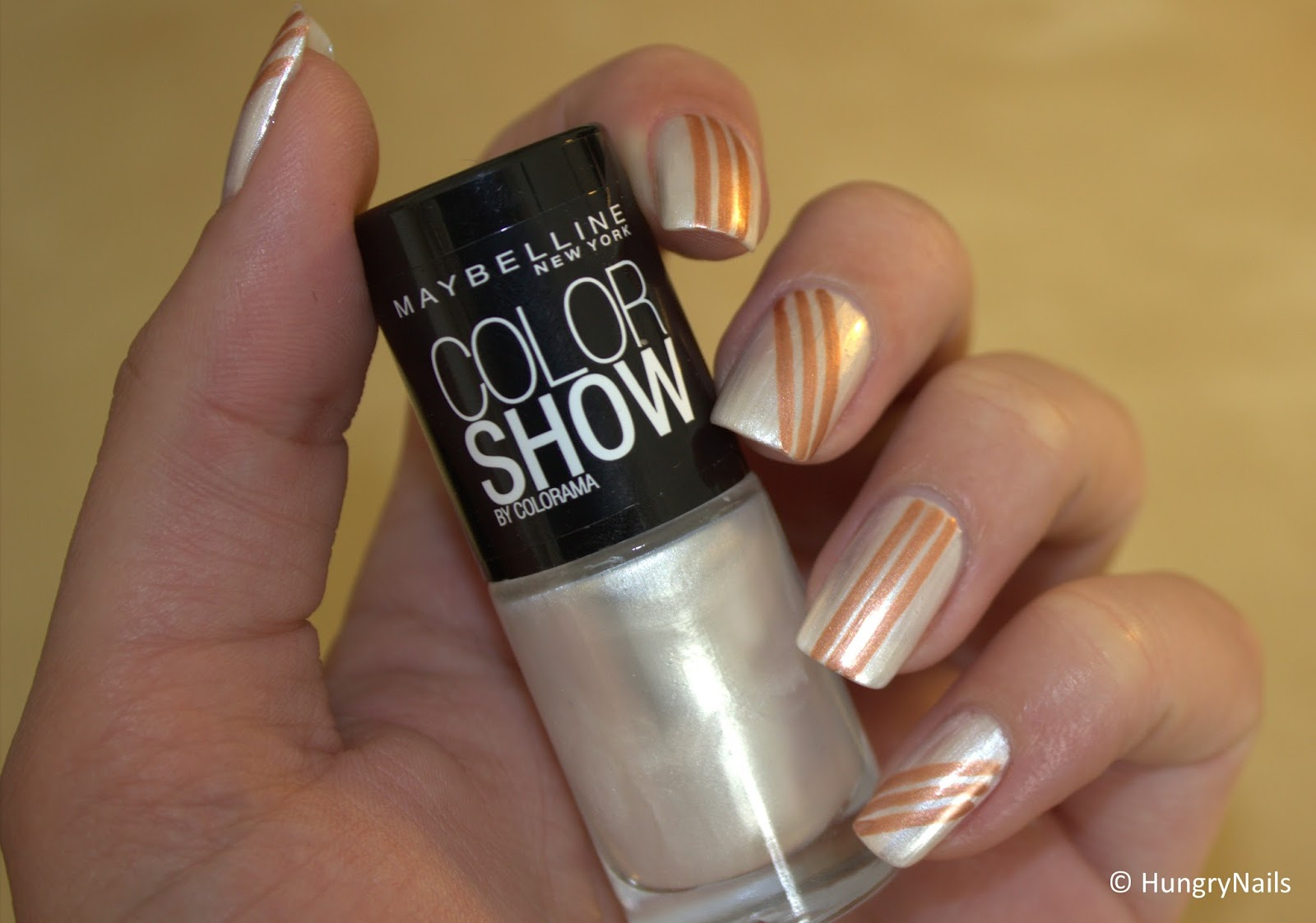 http://hungrynails.blogspot.de/2014/06/maybelline-woche-3-sporty-stripes.html