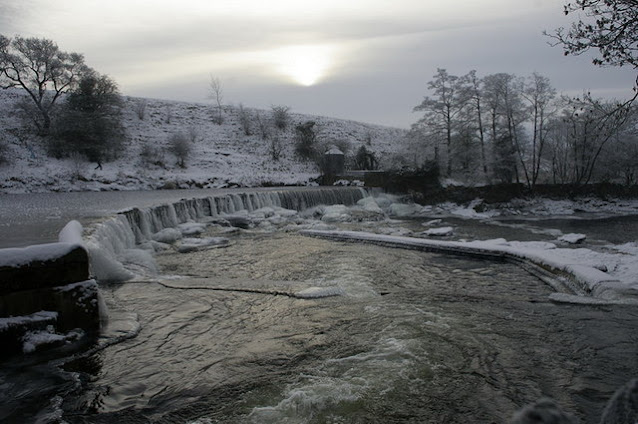 The weir at Waddow Hall, covered in ice and snow