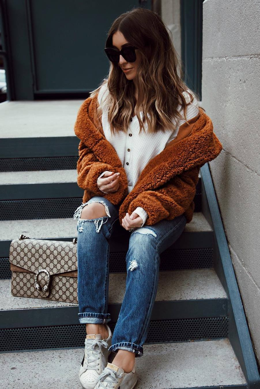 outfit of the day | rips + sneakers + bag + white top + brown fur jacket