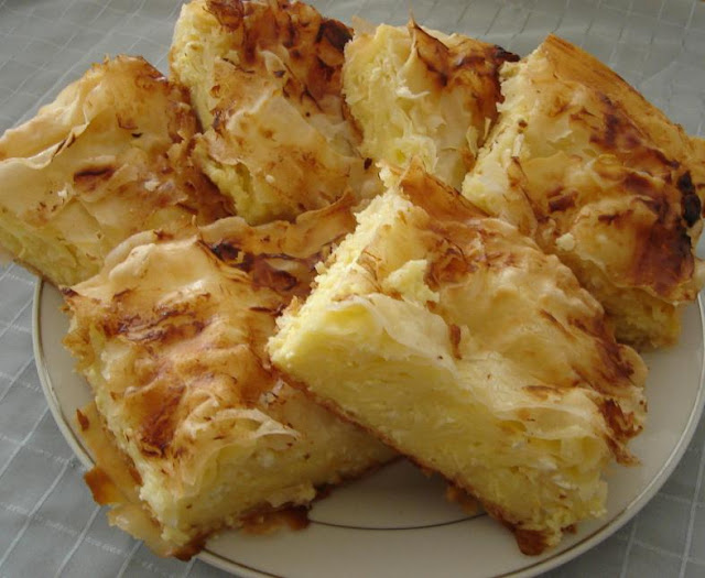 http://macedoniacuisine.blogspot.mk/2016/01/gibanica-quick-pastry-with-eggs-and.html