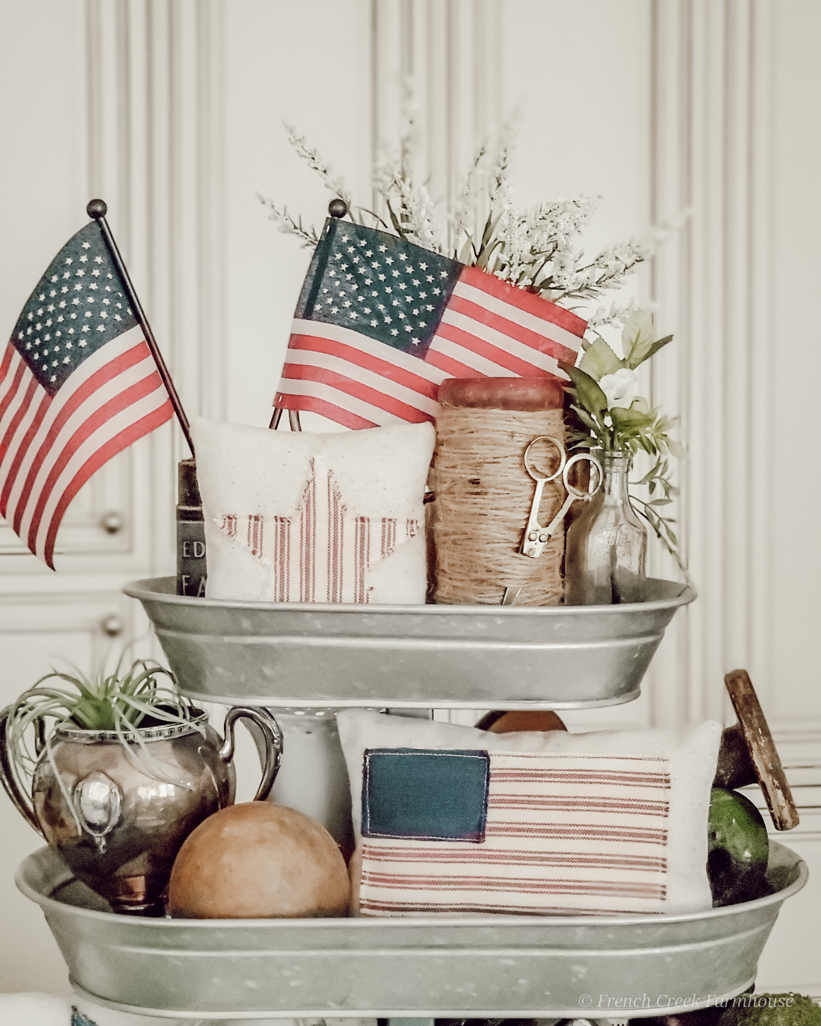 Vintage and American flag decor in a tiered tray