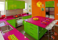 Colorful kitchen design with island in pink green and orange colors