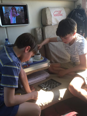Children playing checkers in the train