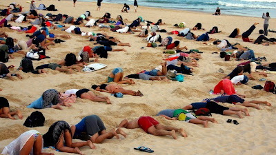 Hundreds gathered on Bondi Beach for the 'head in the sand' protest (Credit: Reuters) Click to Enlarge.