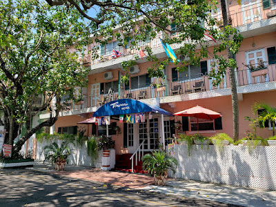 Front of small hotel with shady tree