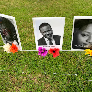 a close up of the black and white headshot of Botham Jean, with flowers