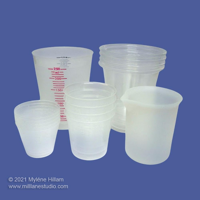 Different sized plastic measuring cup with graduated measurements