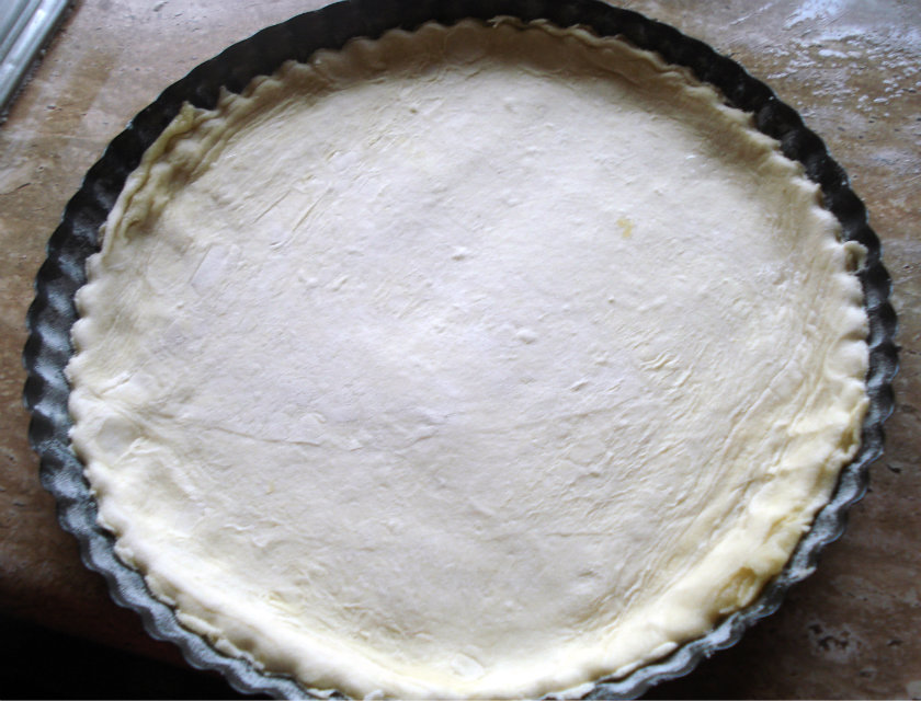 Cut the puff pastry into the circle that fits pie tin
