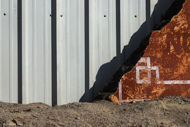 A Minimalist Photograph of an Orange Triangle at a Construction site in Jaipur.