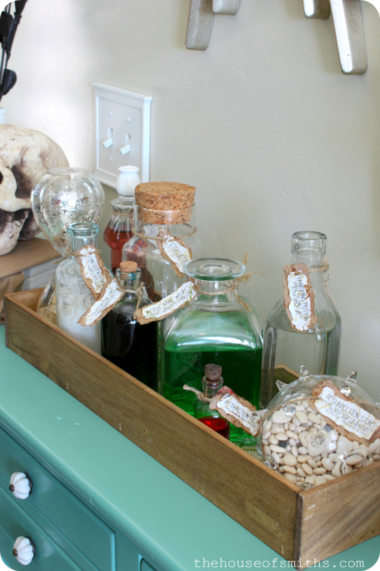 DIY Potion Bottles with Labels - Halloween Vignette - thehouseofsmiths.com #halloweendecorations