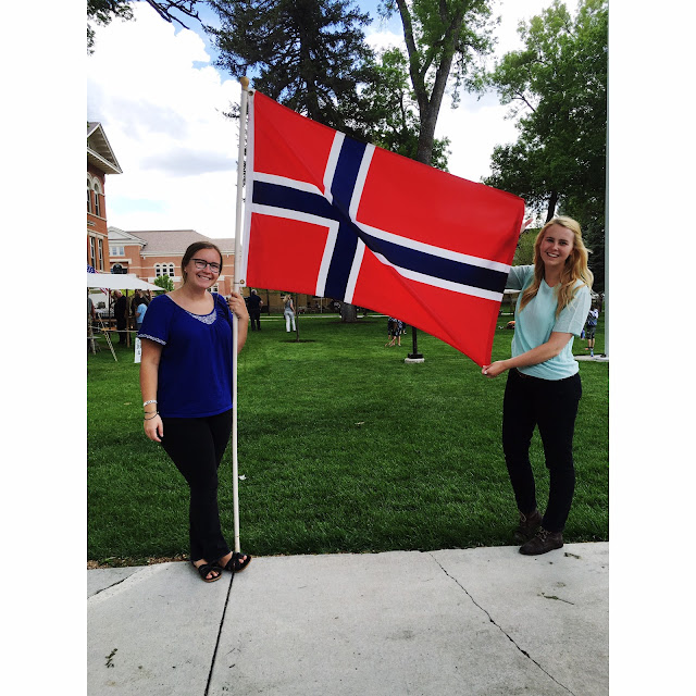 smiling with a norwegian flag