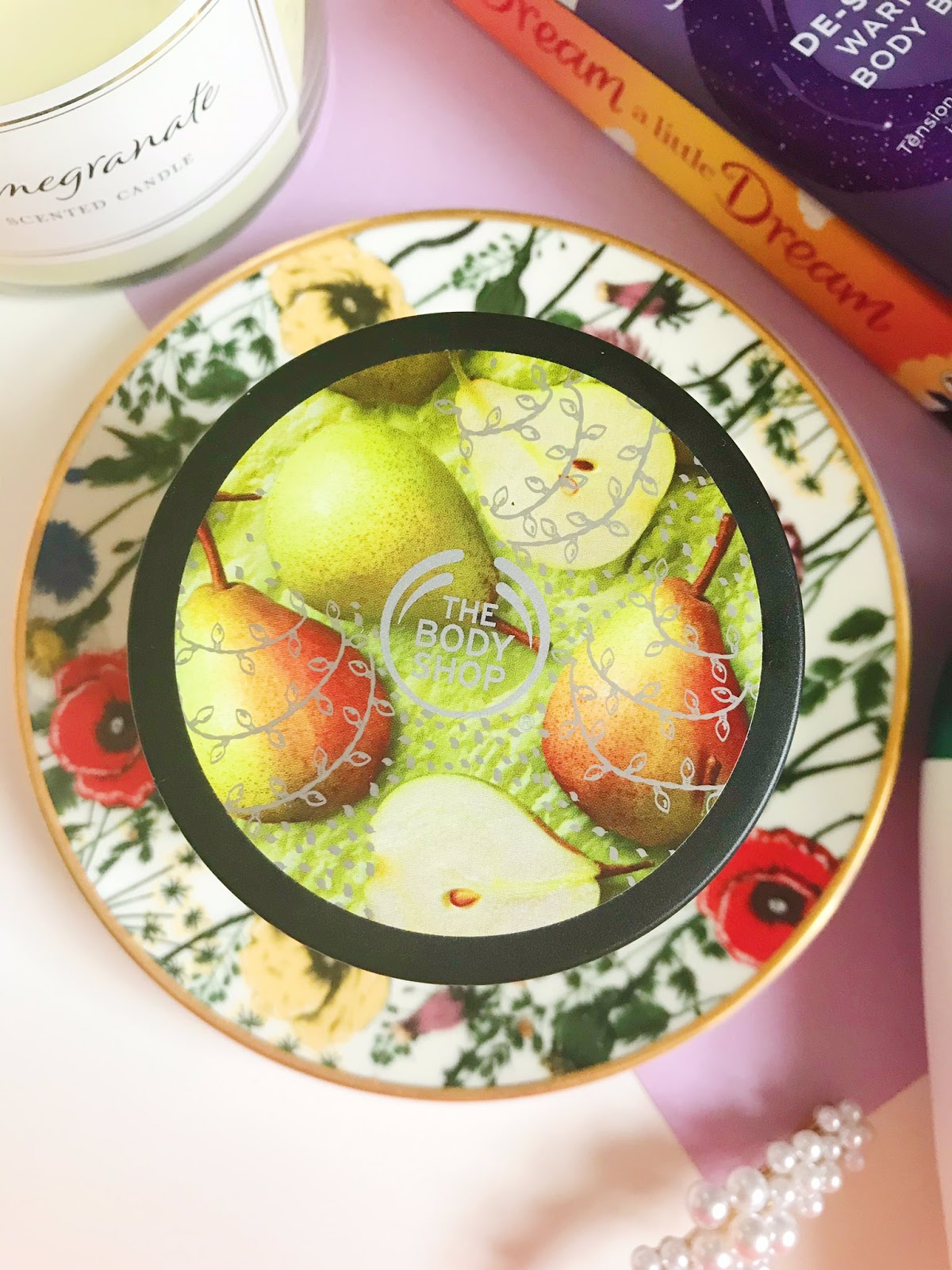 The Body Shop Pear Body Yoghurt on flower trinket dish