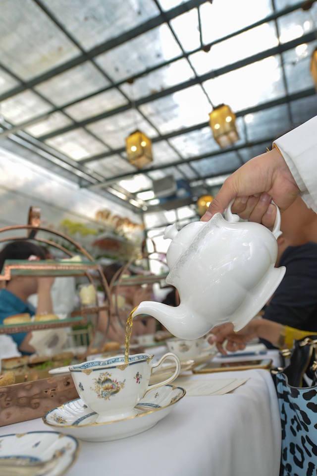 Tea pouring in progress