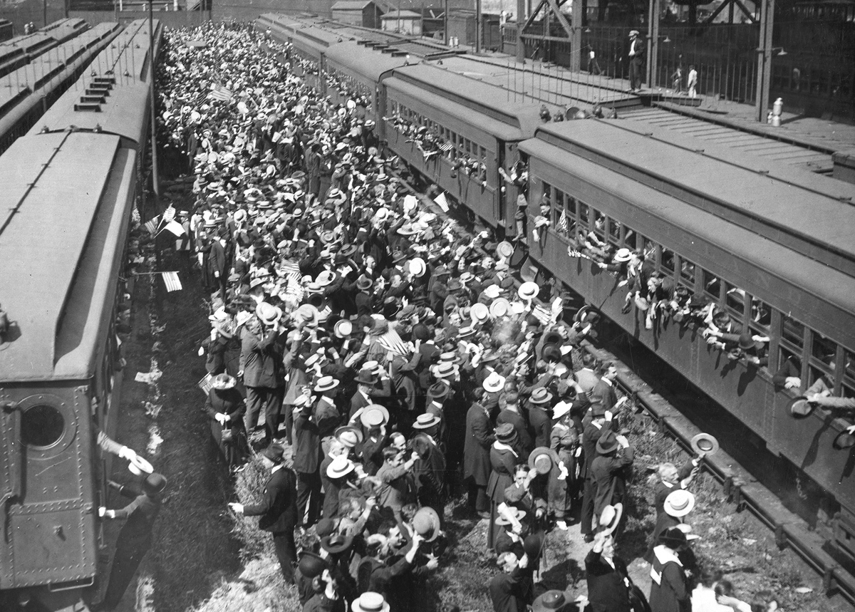 Original caption: Brooklyn's drafted men leaving Long Island R.R. terminal on Flatbush Avenue, for Camp Upton, in September of 1917.