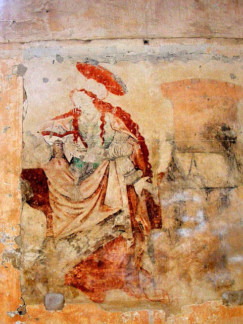 14C wall painting of Mary Magdalene in the church of Saint Maurice la Clouere. France. Photographed by Susan Walter. Tour the Loire Valley with a classic car and a private guide.