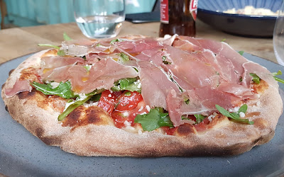 Capocci's Italian Restaurant main pizza prosciutto with fresh ingredients over baked dough with tomatoes