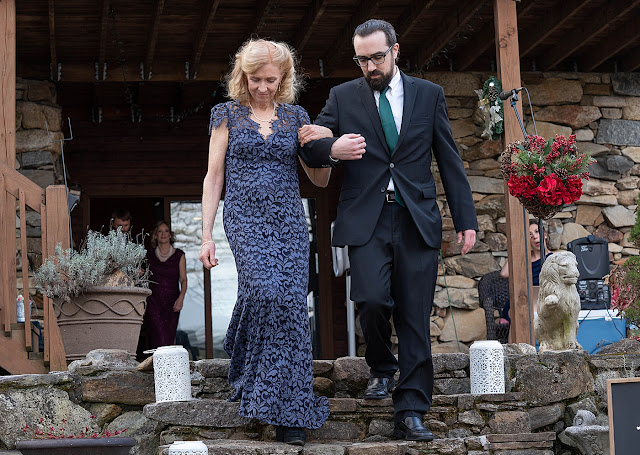 Groomsman escorting parent of wedding party ceremony Magnolia Farm Asheville Wedding Photography captured by Houghton Photography