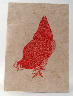 Hen linocut in red ink