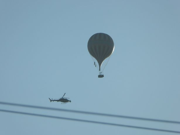 The hot-air balloon and helicopter in the skies on Thursday