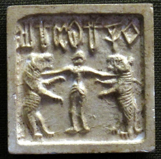 Mohenjo-Daro seal depicting a man between two tigers.