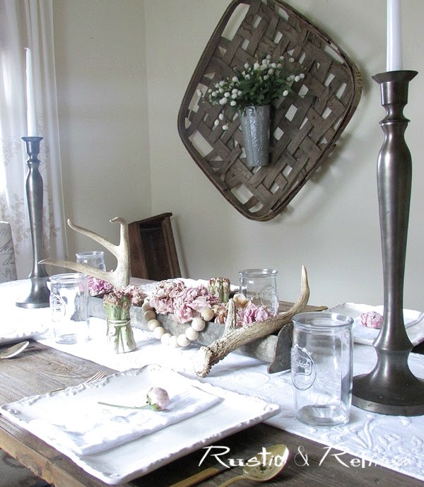 entertaining family and friends by setting the table