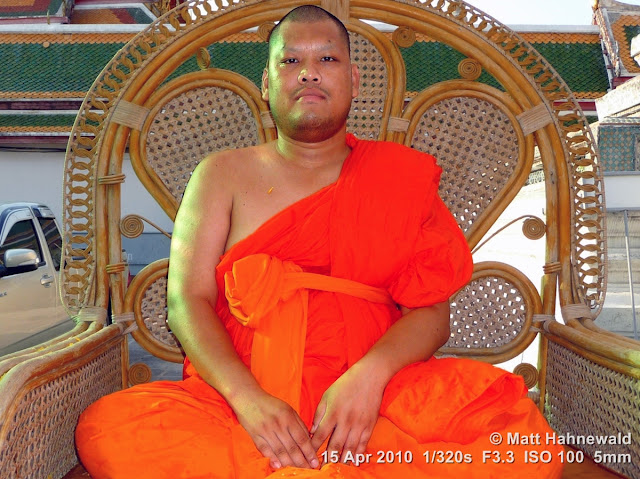 Matt Hahnewald; Facing the World; people; portrait; street portrait; Thailand; Buddhism; Buddhist monk; orange robe; shaved head; saffron robe; Theravada Buddhism; bhikkhu; temple; Bangkok; religion; culture; face