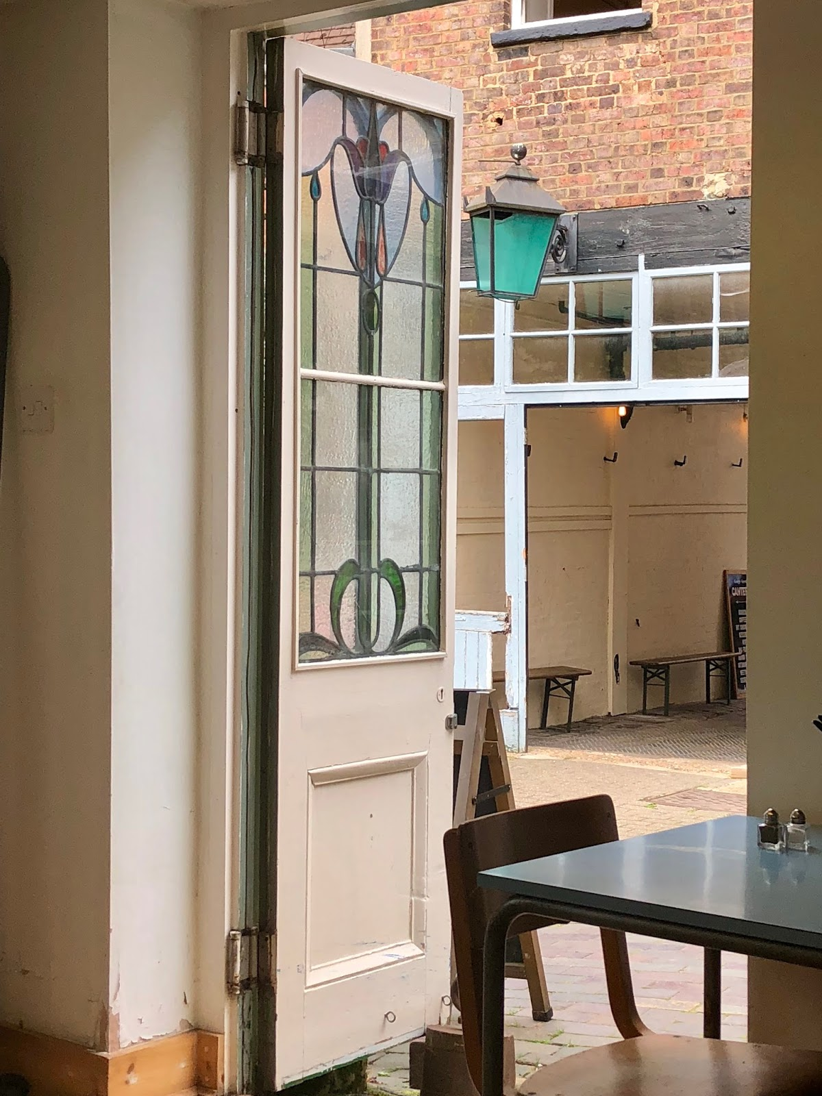 Door and Table in a Cafe