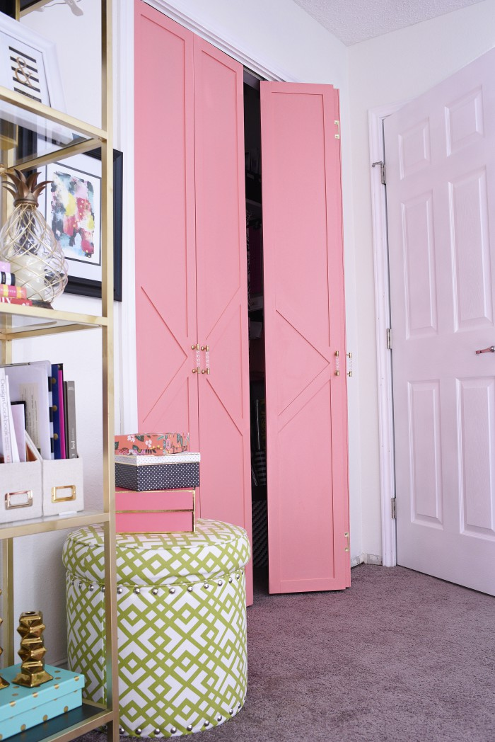 This DIY bifold closet door makeover looks like a million bucks but cost under $50. The paint used in the tutorial is Sherwin-Williams Dishy Coral in a satin finish. The gold and acrylic pulls really make the doors look high-end.