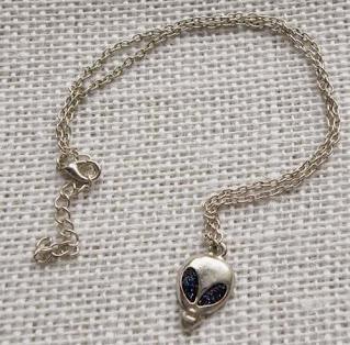 Blue glitter alien head necklace