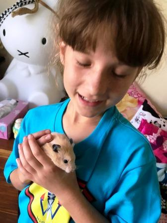 Girl with hamster