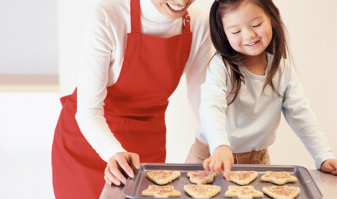Child helping to make holiday cookies