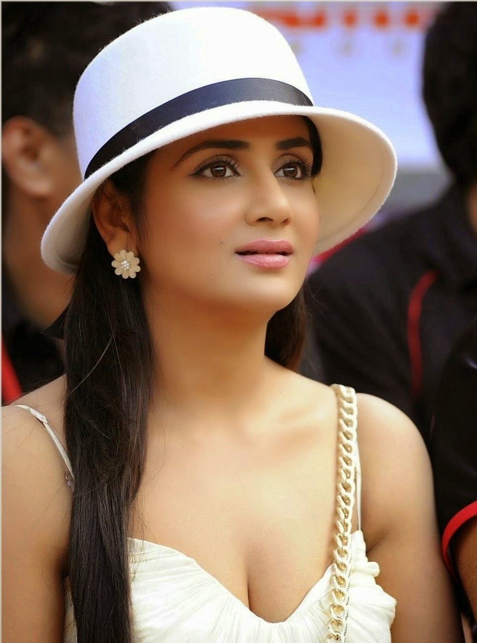 Parul Yadav Hot Stills With Cap In White Dress